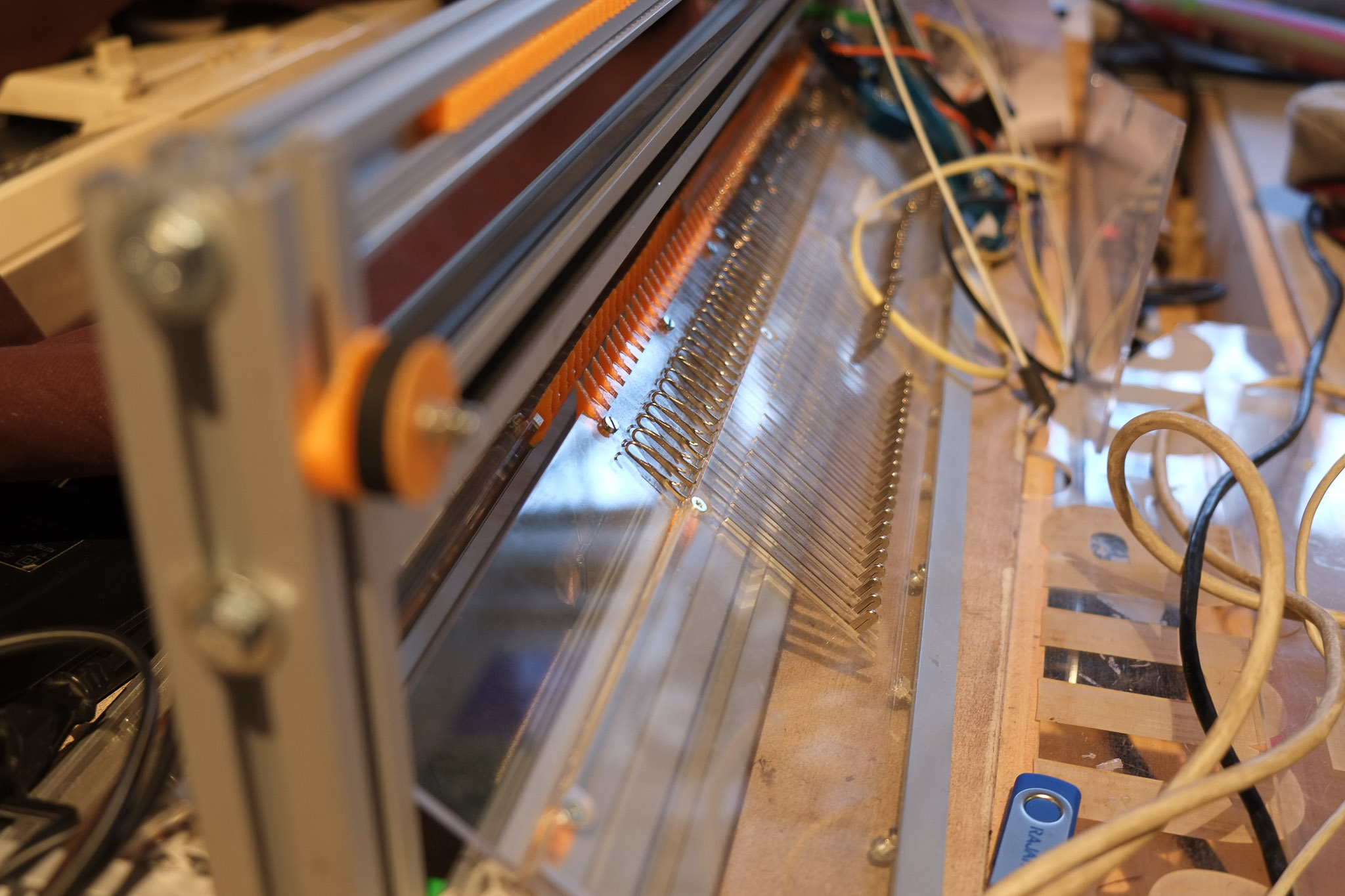 a photograph of a free open source electronic knitting machine, close-up