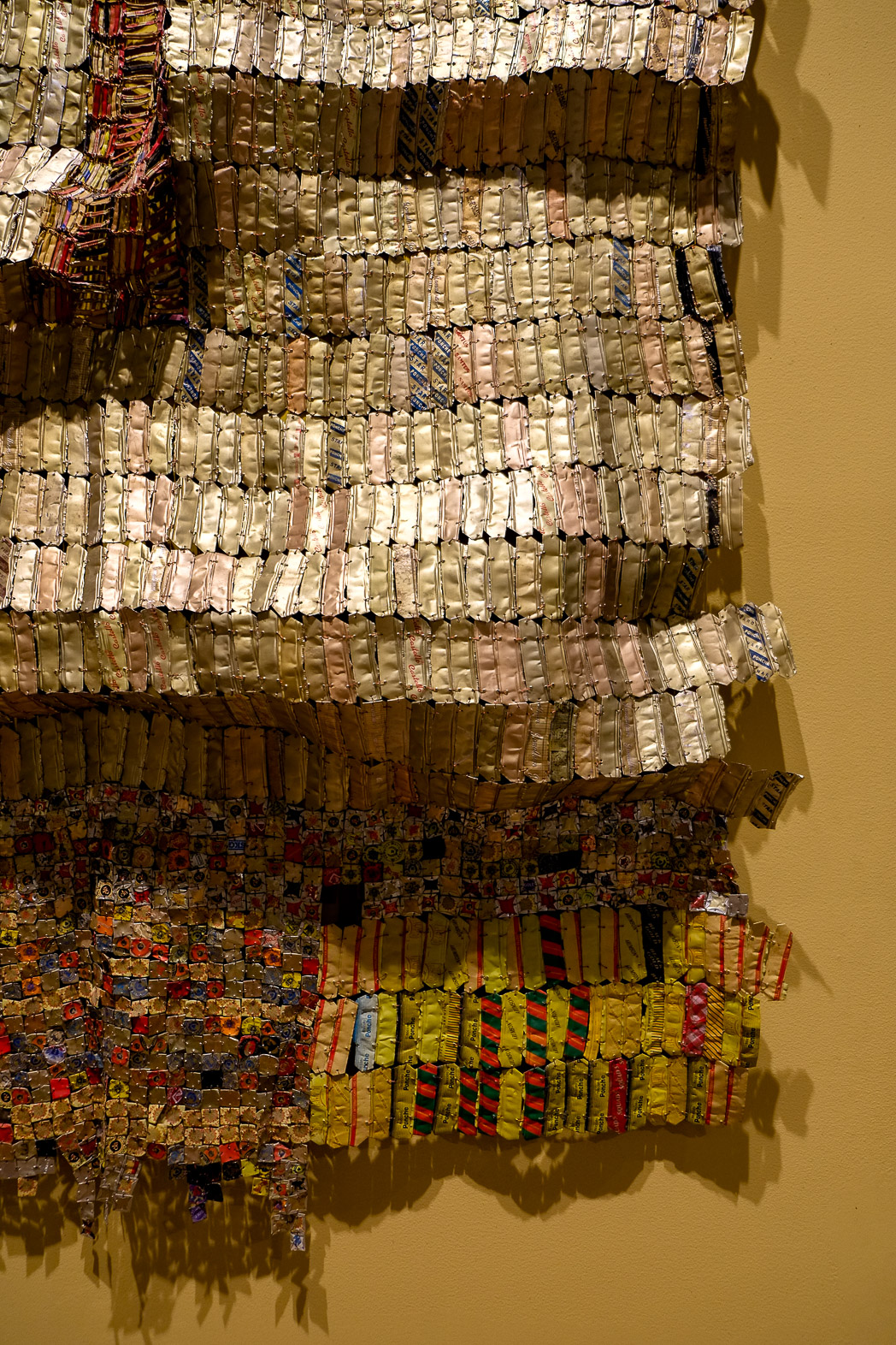 photograph of a detail of the artwork Between Heaven and Earth at the Met, which is made of reclaimed tin cut into mosaic shapes that are then connected together with wire