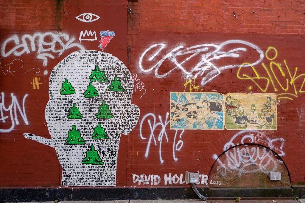 a photograph of graffiti on a wall