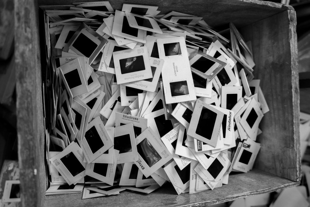 a black and white photograph of a box of slides